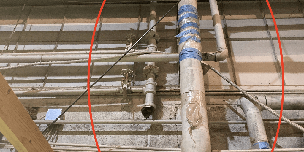 An asbestos insulated pipe in a commercial building.