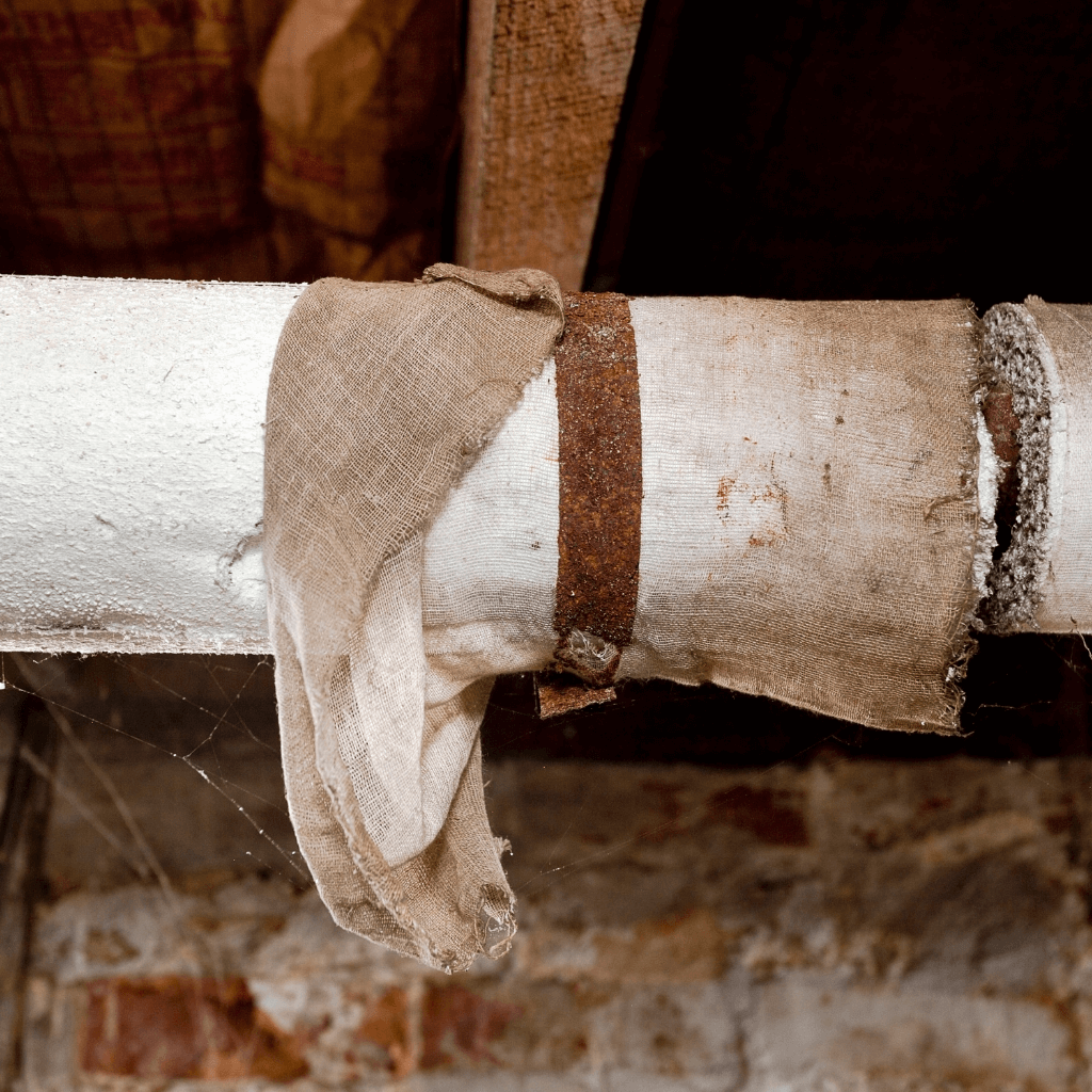 A pipe being tested for asbestos in the basement of a home.